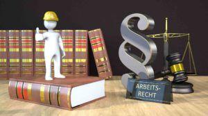 Arbeiterfigur auf Rechtsbücher, Paragraphszeichen